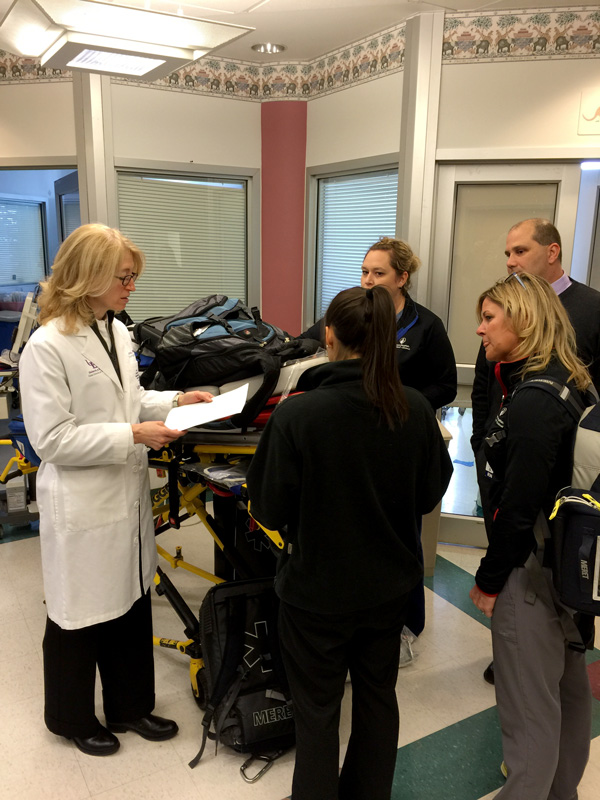 Dr. Bass speaks with paramedics